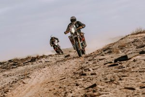 Nicola Dutto on his especially equipped KTM and one of his ghost riders, Sefano Baldussi, following behind.