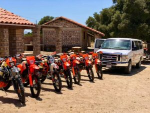 new tour with all the ktm bikes lined up along with the chase vehicle.