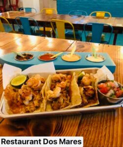 shrimp tacos served with a variety of sauces.